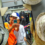 Lim Kah Meng shopping with young boy