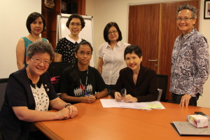 Miggie at signing of the Scholarship Agreement