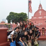Study Trip to Malacca - Kah Meng is in the red T-shirt in front of the flag