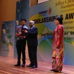 Jun Chow receiving his scholarship