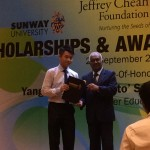 Nicholas Chong receiving his scholarship