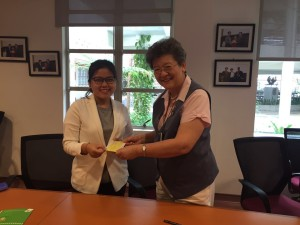 wei-kuan-receiving-her-first-cheque